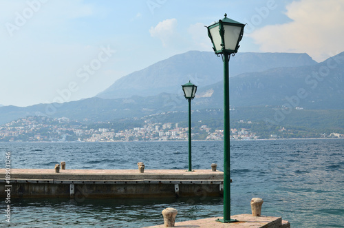 Two green lanterns on sea docks in the Bay of Kotor, in Montenegro
