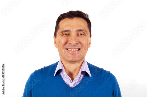Portrait of a smiling adult man in blue sweater