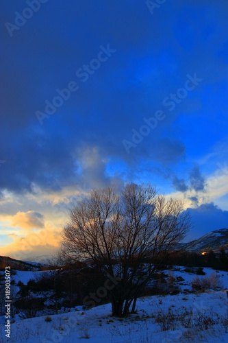 Fotobehang Donkerblauw snowy landscape with a sunset in Cerdagne,Pyrenees orientales in south of France