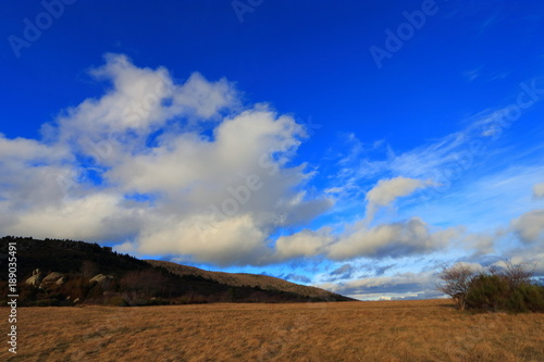 Fotobehang Donkerblauw landscape and cloudy sky in Pyrenees. Occitanie in south of France