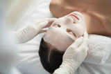 Top view close up of peaceful girl relaxing at spa with facial mask. Skincare concept - 189035806