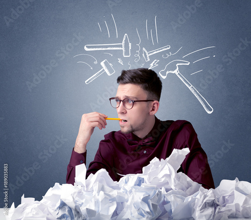 Businessman above crumpled paper