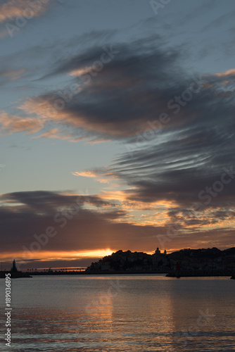 Foto op Canvas Liguria Stormy clouds of contrasting color over the evening city