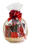 gift basket packed in transparent paper with a big red bow isolated on a white background - 189043221