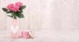 Flowers composition for Valentine's, Mother's or Women's Day. Pink flowers on old white wooden background.