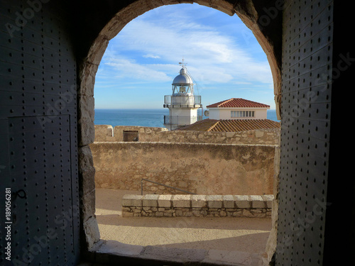 Peñiscola Lighthouse and the Sea as seen from within the Castle Entrance