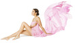 Woman Body Beauty Care, Sexy Model in Pink Flying Flowing Dress Cloth Sitting over White Background