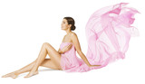 Woman Body Beauty Care, Sexy Model in Pink Flying Flowing Dress Cloth Sitting over White Background - 189059826
