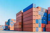 Industrial port with containers box for logistic export import business with clear blue sky in background