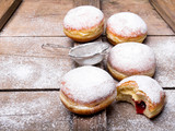 Traditional Polish donuts on wooden powder. Tasty doughnuts with jam. - 189102491