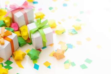 Colored gift boxes with colorful ribbons. White background. Gifts for Christmas or a birthday.