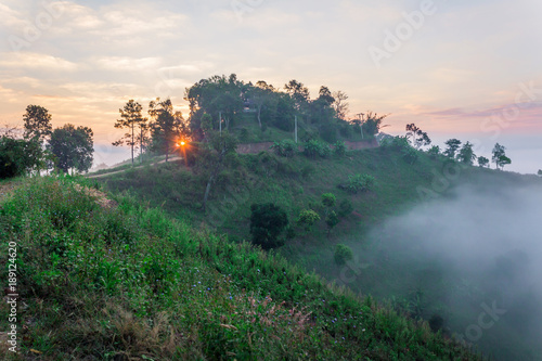 Deurstickers Groen blauw Mountain and fog at morning time with sun ray, beautiful landscape