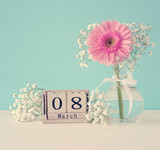 Image of International women day concept with beautiful flower in the vase on wooden table. - 189131065