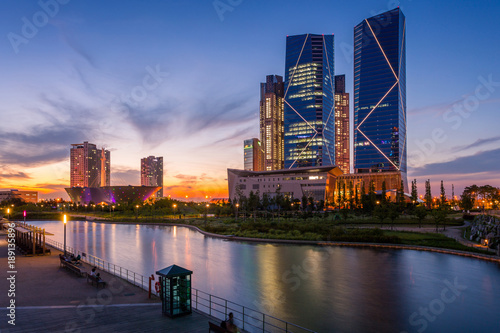 Seoul city with Beautiful after sunset, Central park in Songdo International Business District, Incheon South Korea.