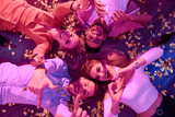 Top view at group of  happy young people gesturing hearts and thumbs up lying on floor among confetti and looking at camera during awesome house party. - 189137424