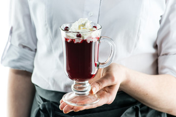 The unidentified waiter holding a glass cocktail with whipped cream and lemon juice