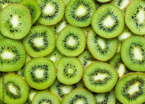 a lot of kiwi slices as textured background