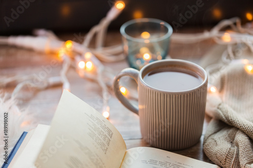 Fotobehang Chocolade book and cup of coffee or hot chocolate on table