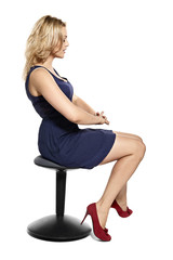 Sexy Young Blonde Woman Sitting on Stool