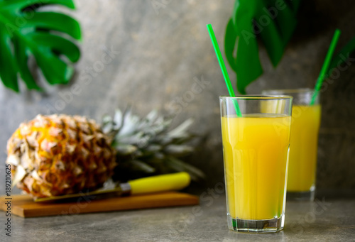 Tuinposter Sap Pineapple freshly squeezed juice in two glasses