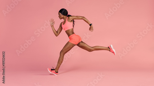 African female runner sprinting