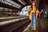 woman walk by railway station