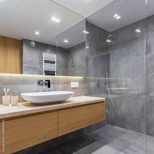Gray bathroom with long countertop