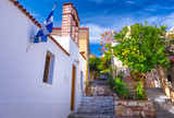 Street of Anafiotika in the old town of Athens, Greece. Anafiotika is district built by workers from the island Anafi. Popular tourist attraction. - 189255006