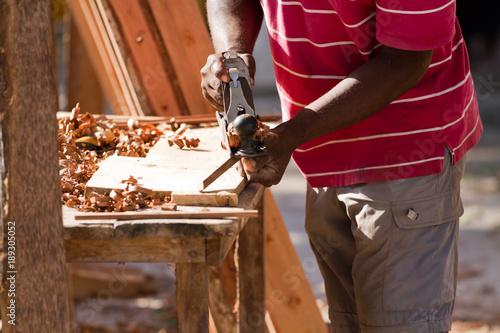 Fotobehang Zanzibar carpenter at work in zanzibar