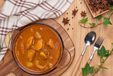Chicken curry with spice on wooden background - 189305810