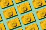 Retro yellow cameras on green background - 189309608