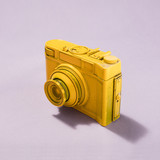 Camera standing on pastel pink background - 189309804