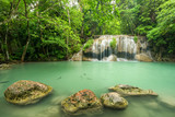 Fototapety Wonderful green waterfall and nice for relaxation, Breathtaking and amazing green water at the evergreen forest, Located Erawan waterfall Khanchanaburi Province, Thailand