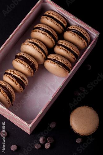 Aluminium Macarons Chocolate macarons in a pink box, black background