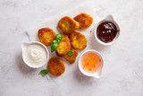 Fried crispy chicken nuggets with sauces - 189324856