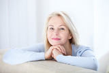 Active beautiful middle-aged woman smiling friendly and looking in camera. Woman's face closeup. Realistic images without retouching with their own imperfections. Selective focus. - 189325471