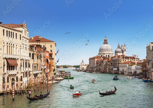 Foto Murales Venice, the Grand canal, the Cathedral of Santa Maria della Salute and gondolas with tourists