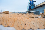 Large empty wooden coils. The new cable drums at the industrial area. Outdoors - 189346665