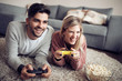 Young couple playing video games