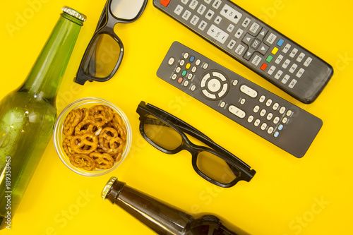 Weekend, Leisure, Lifestyle Concept with two TV remote controls, two pairs of 3d Poster