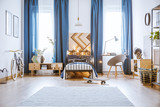 Skateboard in spacious bright bedroom - 189368426
