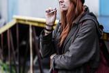 Teenager smoking cigarette - 189369223