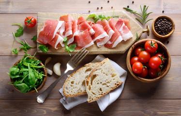 Cutting board with raw ham