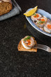 Rolled herring in vinegar, served with onions and lemon. Russian Appetizer. - 189385461
