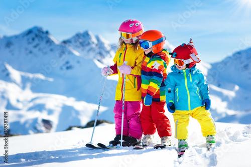 Leinwandbild Motiv Ski and snow winter fun for kids. Children skiing.