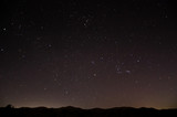 Nighttime sky with stars above horizon in Oman