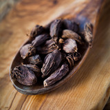 Black Cardamon Seeds  - Indian spices on wooden spoon, macro. - 189409424