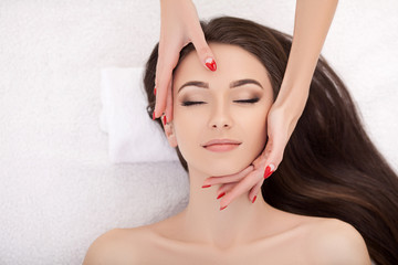 Woman under professional facial massage in beauty spa © Maksymiv Iurii