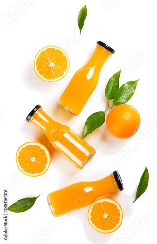 Fototapeta Juice of orange fruit, above view.