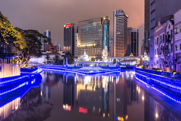 The office buildings reflects in the water of the Klang river in front of the Jamek mosque in the heart of Kuala Lumpur in Malaysia.
